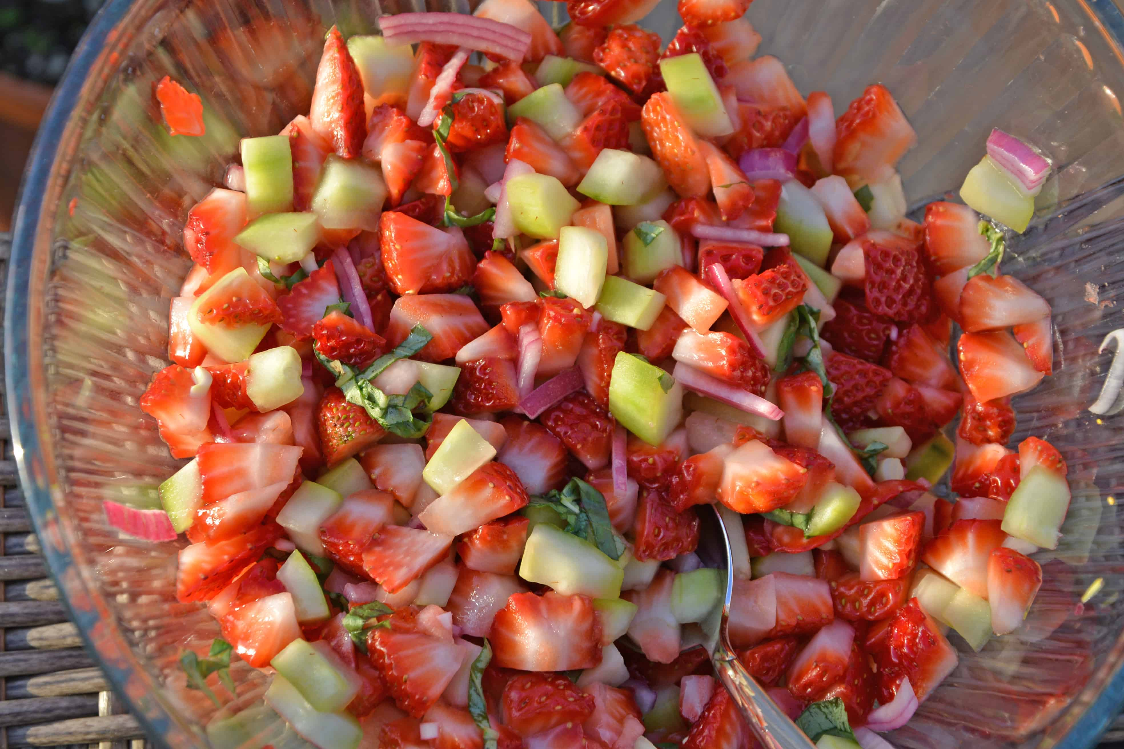 This Strawberry Salsa recipe uses sweet strawberries with cooling cucumber, red onion, basil and zesty white wine vinegar for a juicy dip or condiment. #homemadesalsa #fruitsalsa #strawberrysalsa www.savoryexperiments.com