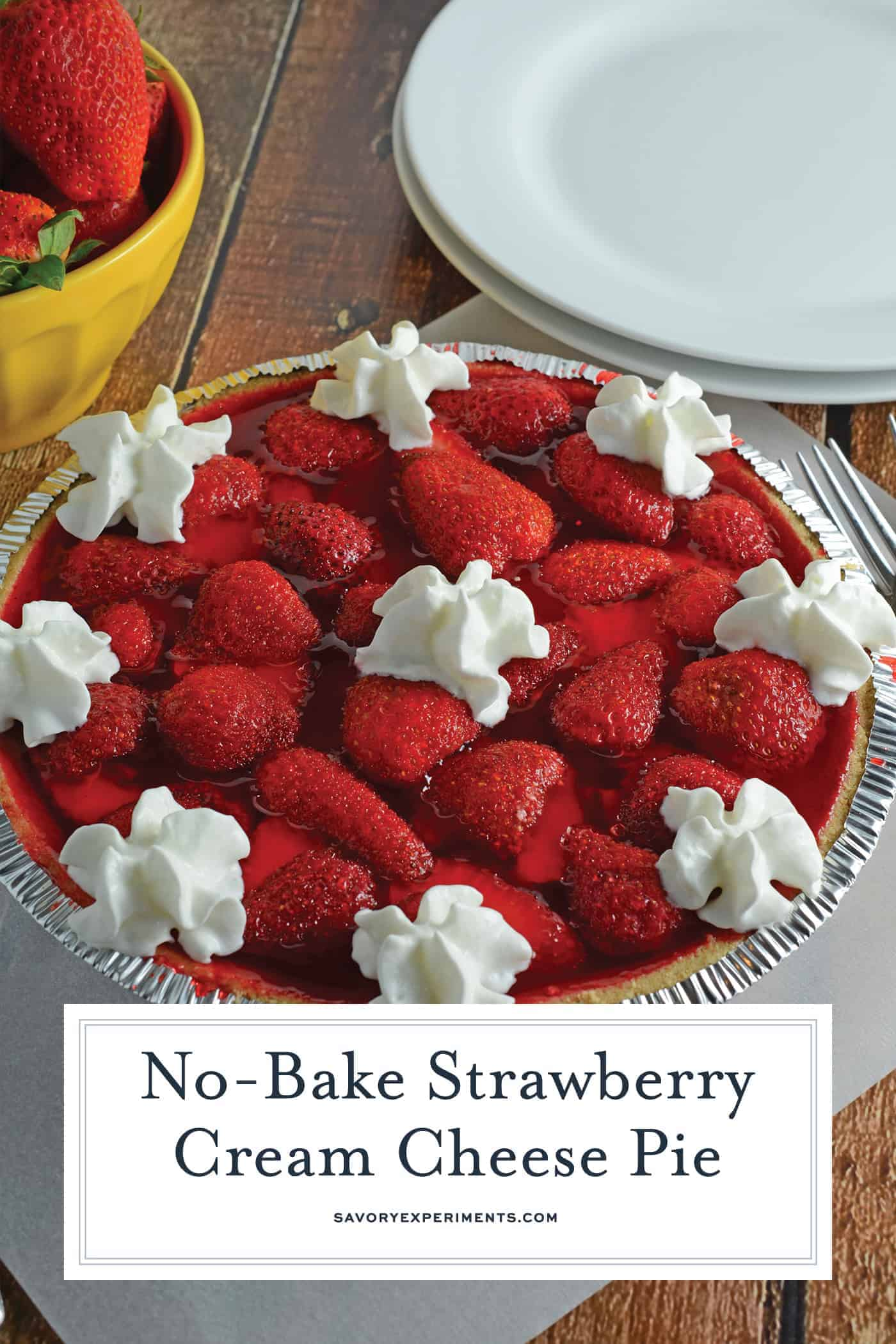 No-Bake Strawberry Cream Cheese Pie- A no-bake pie made with graham cracker crust, a layer of sweet cream cheese, loads of fresh strawberries and a homemade strawberry jelly. All ready in less than 20 minutes! www.savoryexperiments.com