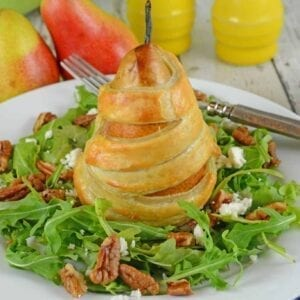 Pear Salad with Candied Walnuts is the perfect winter salad for dinner parties and holidays. Honey Balsamic Dressing and tart goat cheese make the best salad recipe!