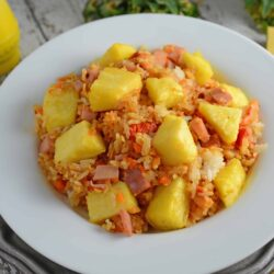 Pineapple Fried Rice Recipe - A quick and easy weeknight meal that's so much cheaper, tastier and healthier than take-out! Make it a vegetarian meal or add ham. www.savoryexperiments.com
