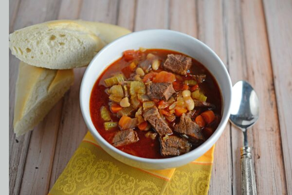 Short Rib Soup Recipe- a hearty comforting soup made with vegetables and shredded short ribs. Also known as Booyah in parts of the US. This soup can be served as an appetizers or entree and freezes well.