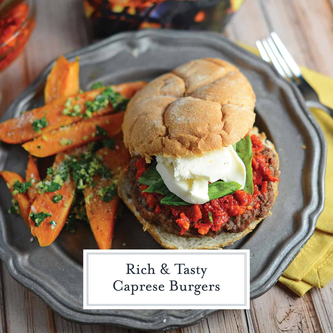 Caprese Burgers are smothered with a red pesto, fresh mozzarella and basil all on a flame-grilled burger. The best gourmet burger out there! #capreseburgers #gourmetburgers www.savoryexperiments.com