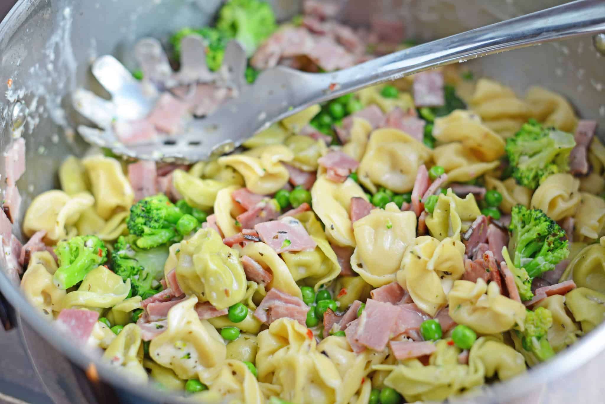 Creamy Tortellini and Ham Pasta - An easy pasta recipe ready in just 20 minutes! Peas, broccoli, ham and cheese tortellini! www.savoryexperiments.com