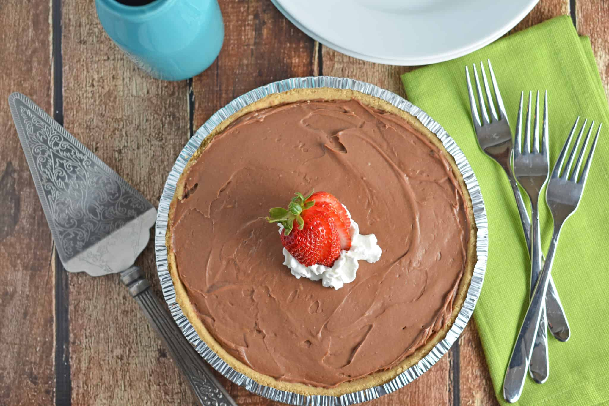 No-Bake Chocolate Cheesecake is a super creamy, quick and easy dessert recipe perfect for BBQs and parties. This dessert whips up in only 10 minutes! www.savoryexperiments.com