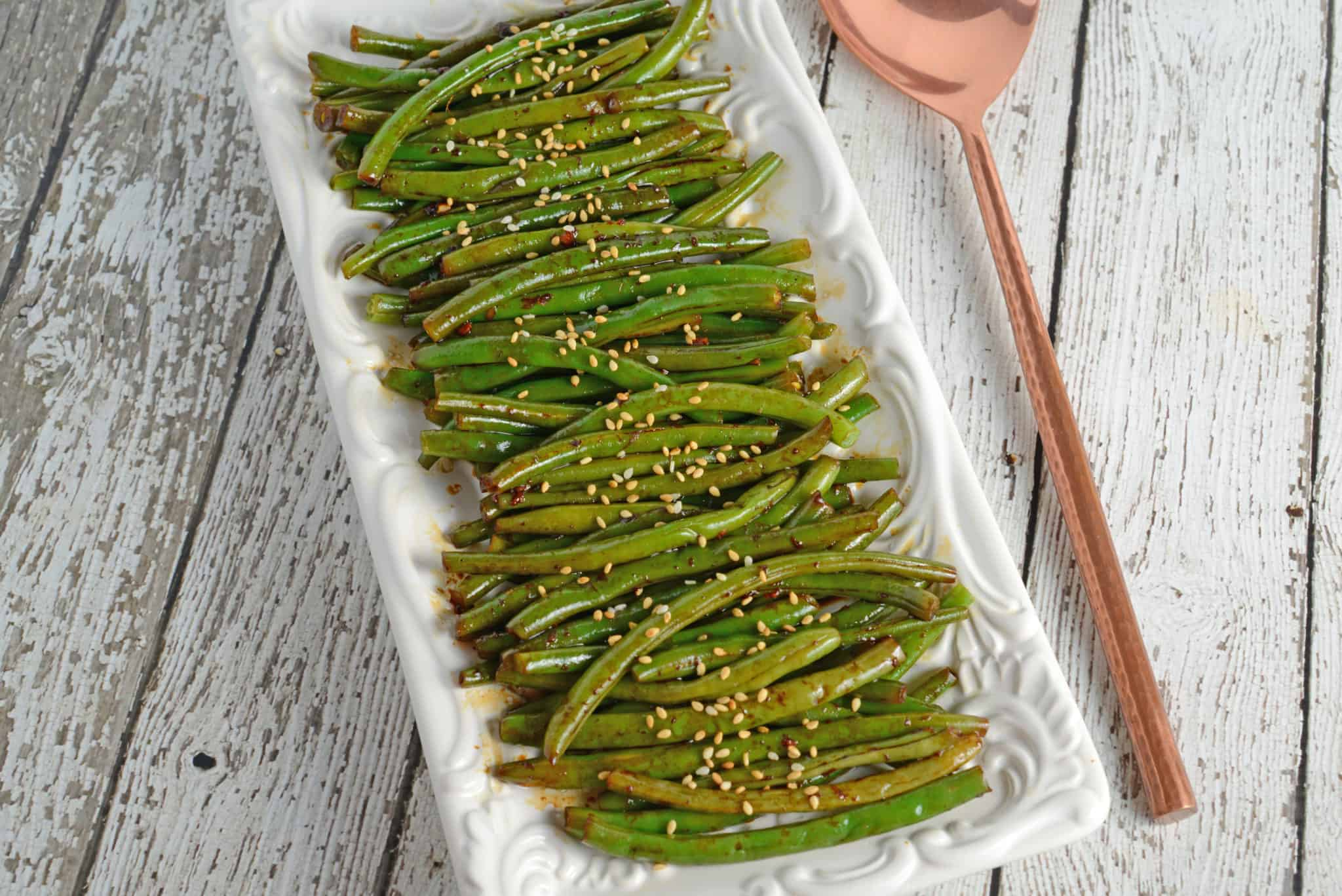 Copycat P.F. Chang's Spicy Green Beans Recipe - Easy, gluten free, garlicky and spicy side dish made with fresh green beans in just minutes. Perfect for any Asian meal. www.savoryexperiments.com