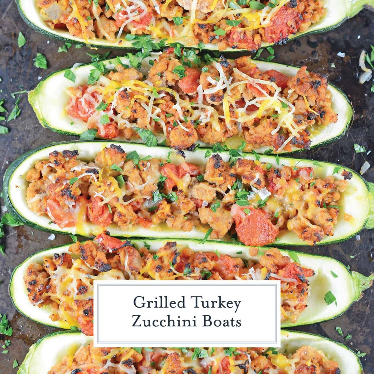 Turkey stuffed zucchini makes the perfect healthy dinner! One of the best zucchini recipes I've ever made. #groundturkeyrecipes #grilledzuchhini www.savoryexperiments.com