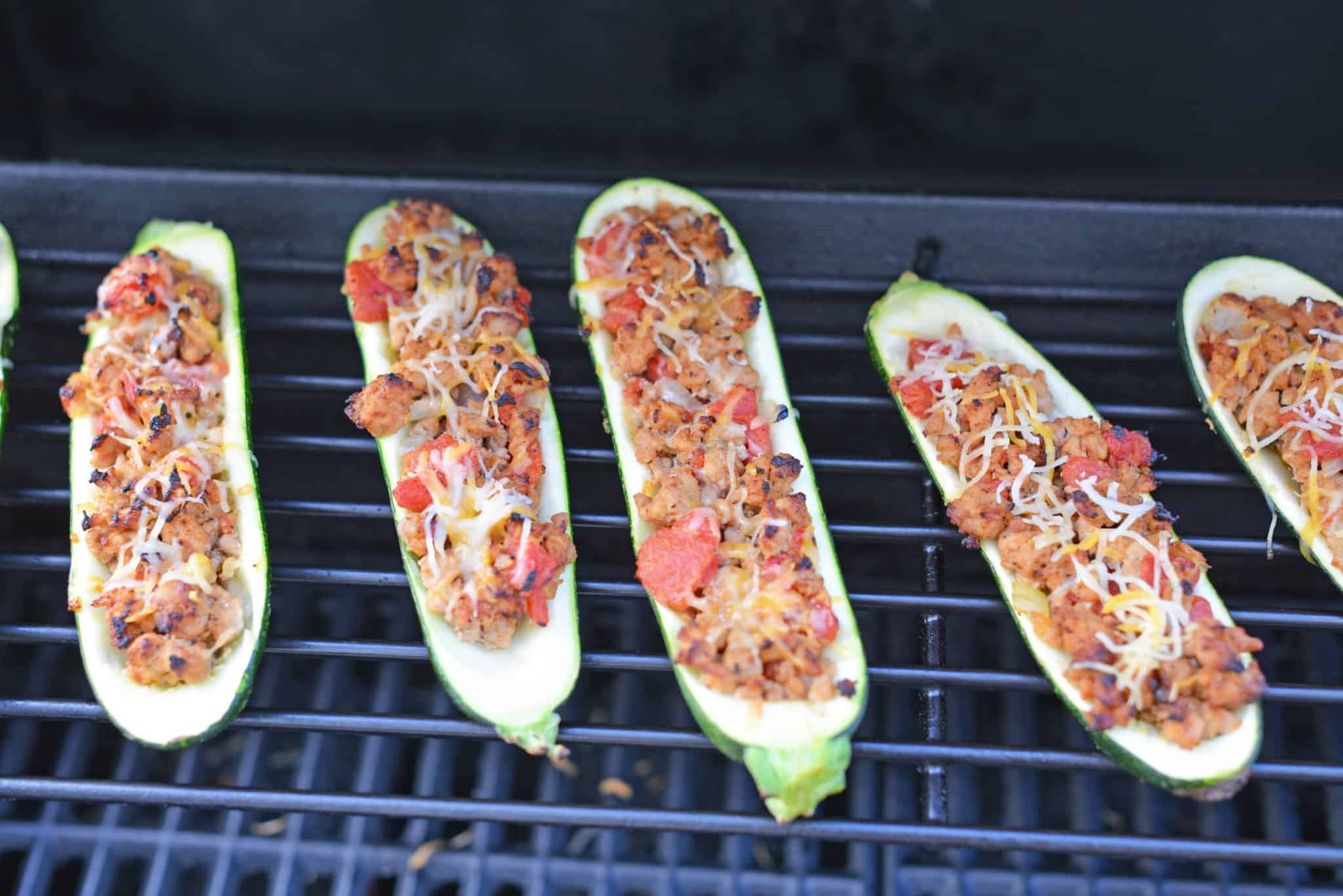 Grilled Turkey Zucchini Boats Recipe - Looking for grilling recipes? Turkey stuffed zucchini makes the perfect healthy dinner! One of the best zucchini recipes I've ever made. www.savoryexperiments.com