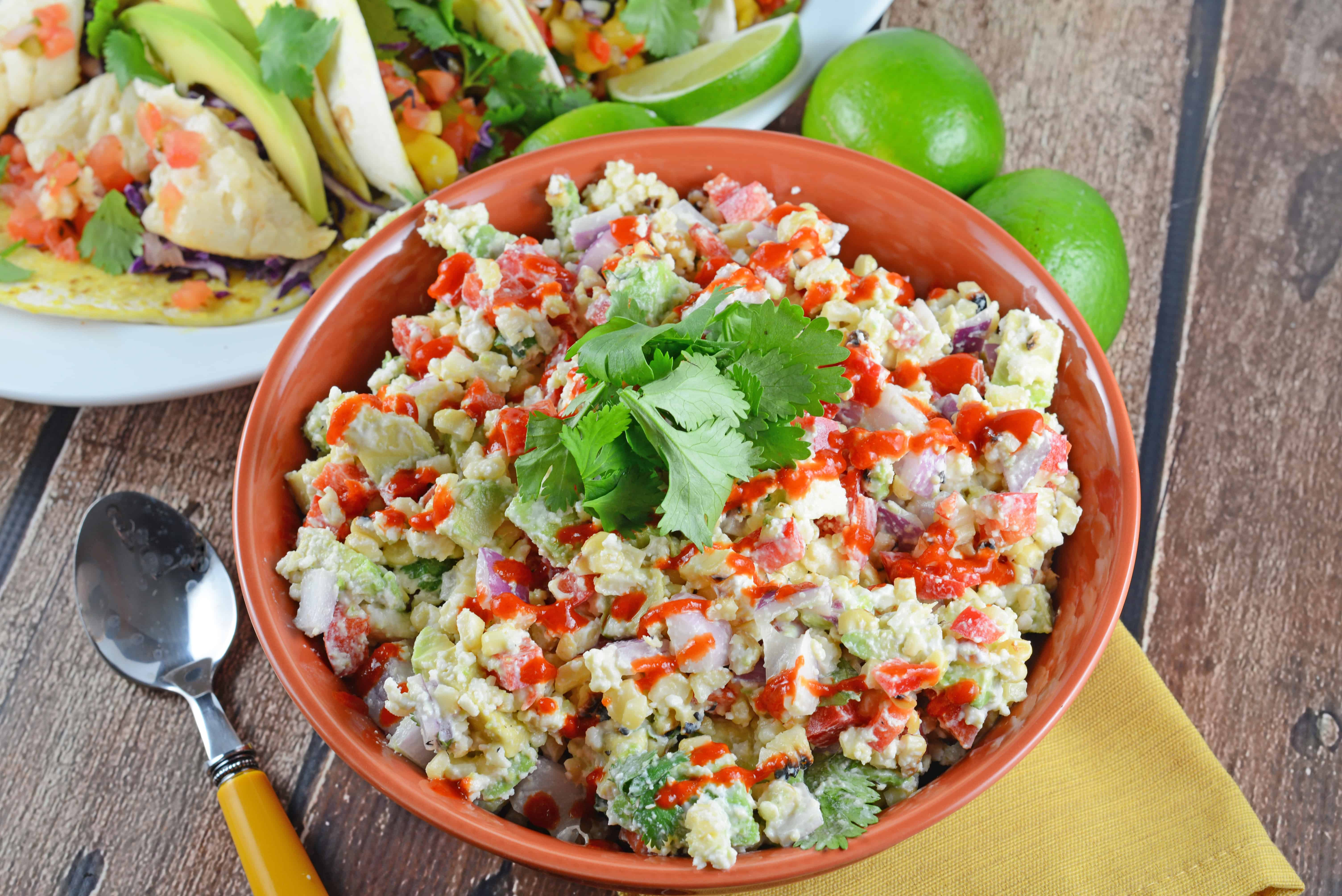 Mexican Corn Salad Recipe - Traditional Mexican street corn is turned into the best salad ever. Lime, Mexican cheese with avocado, red onions and crema mexicana. It's so good, just grab a spoon! www.savoryexperiments.com