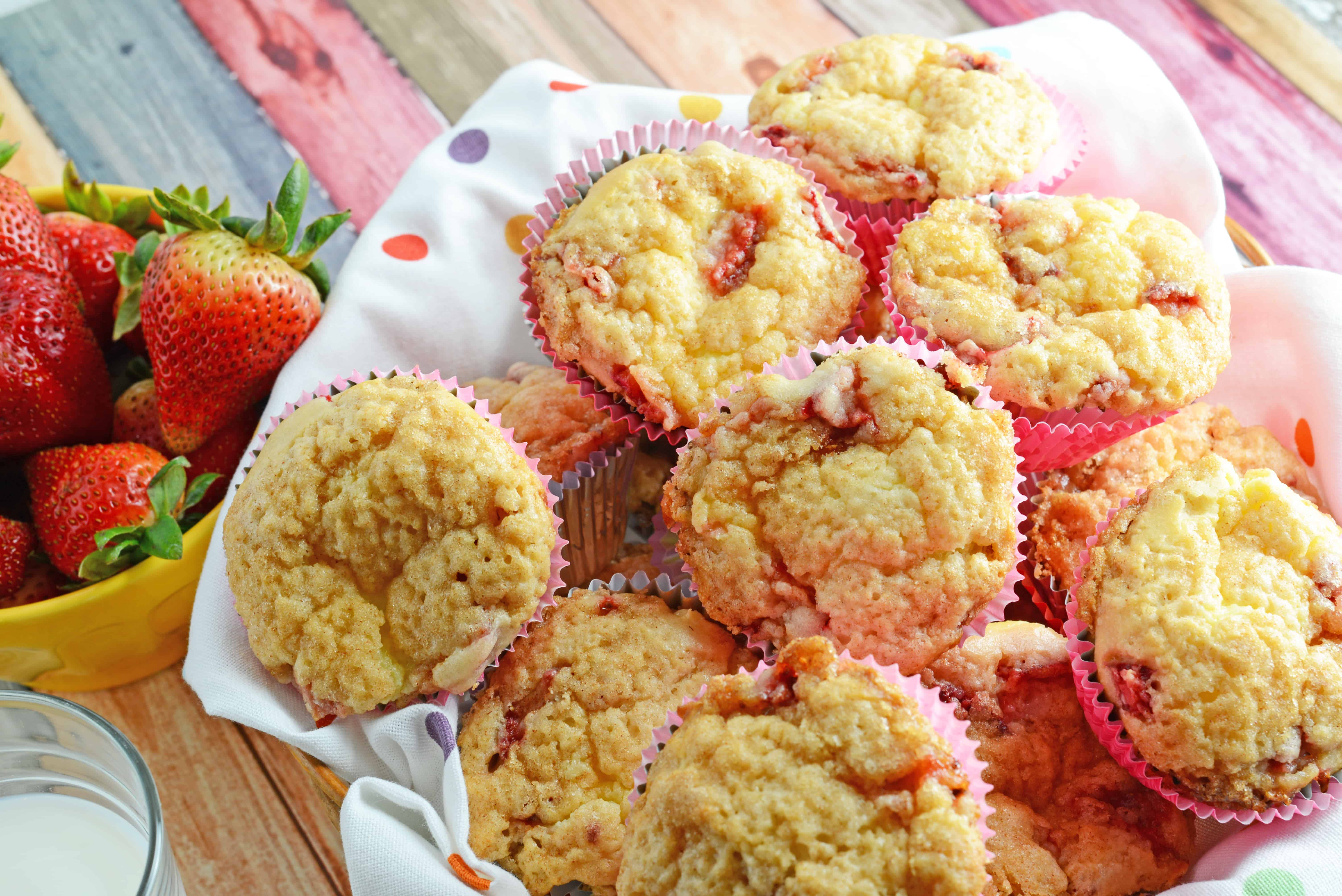 Strawberry Cream Cheese Muffins-- like eating strawberries 'n cream cupcakes for breakfast!! Super moist and creamy using fresh or frozen strawberries. www.savoryexperiments.com