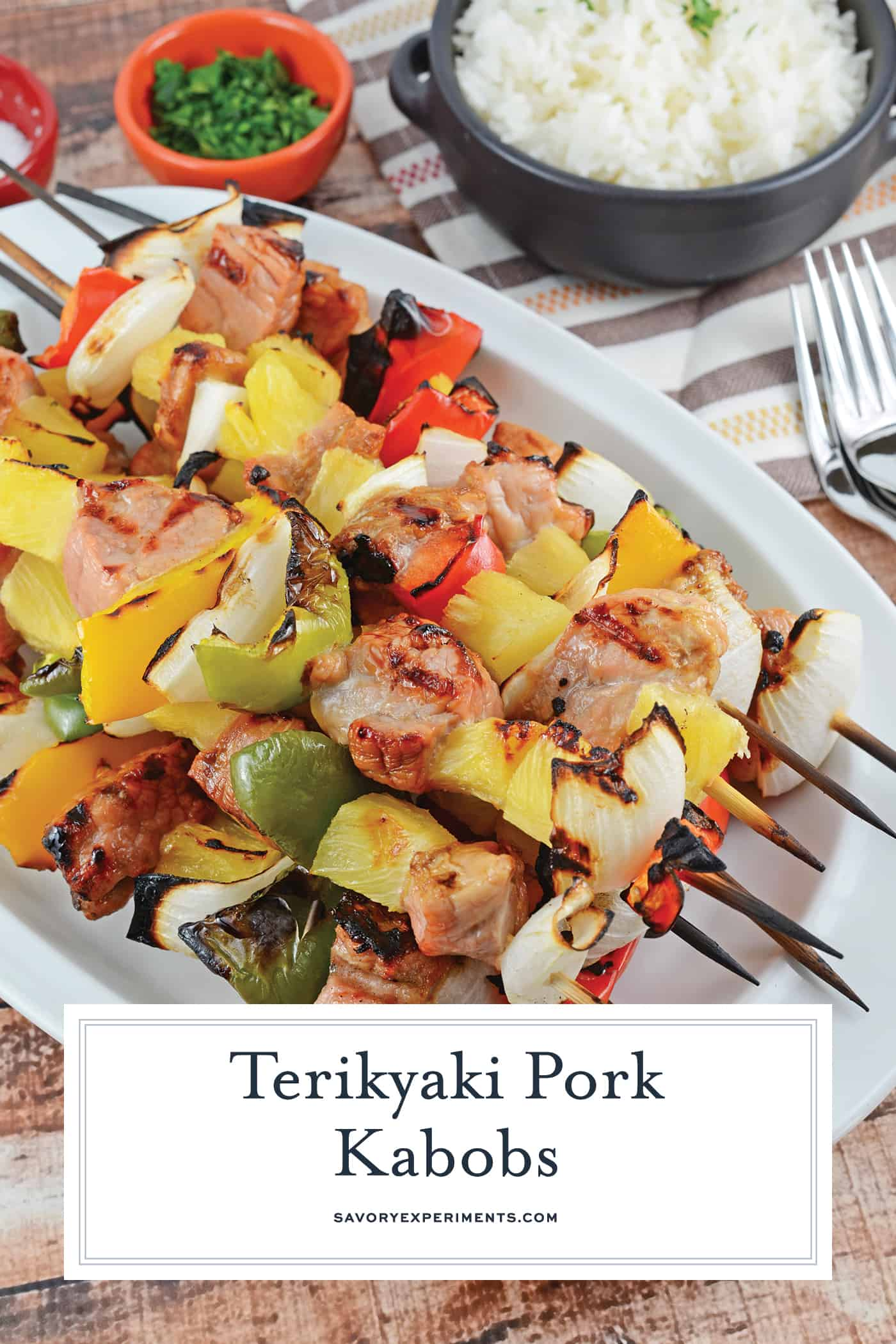 Teriyaki Pork Kabobs are an easy kabob recipe using marinated pork tenderloin paired with pineapple, bell pepper and sweet onion. Ready in 30 minutes! #teriyakipork #kabobrecipes www.savoryexperiments.com