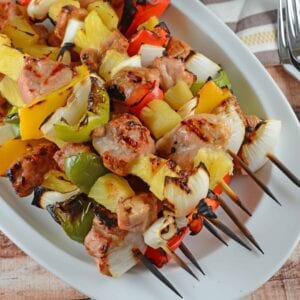 Teriyaki Pork Kabobs Recipe - Kabobs on the grill are a class summer meal. Marinated pork tenderloin paired with pineapple, bell pepper and sweet onion, makes this kabob recipe an quick dinner recipe. www.savoryexperiments.com