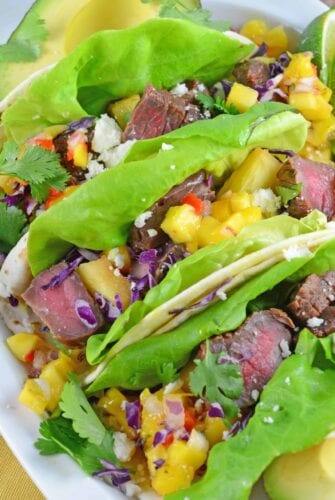 Tropical Beef Tacos Recipe - the secret for interesting and amazing soft tacos! Easy soft tacos with mango salsa, queso fresco and red cabbage. www.savoryexperiments.com