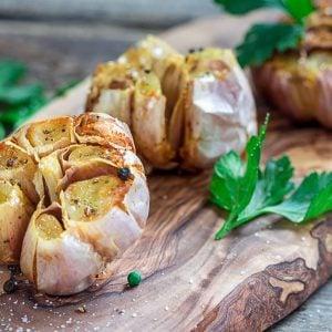 roasted garlic on a wood board