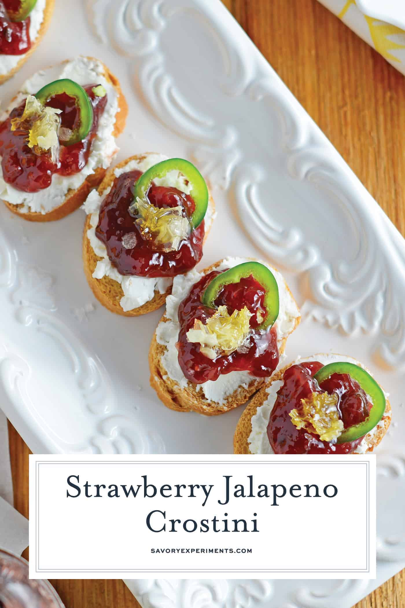 Strawberry Jalapeño Crostini are a sweet heat perfect for a quick snack or entertaining. Sweet, spicy and savory, they are the perfect blend!#crostinirecipes www.savoryexperiments.com