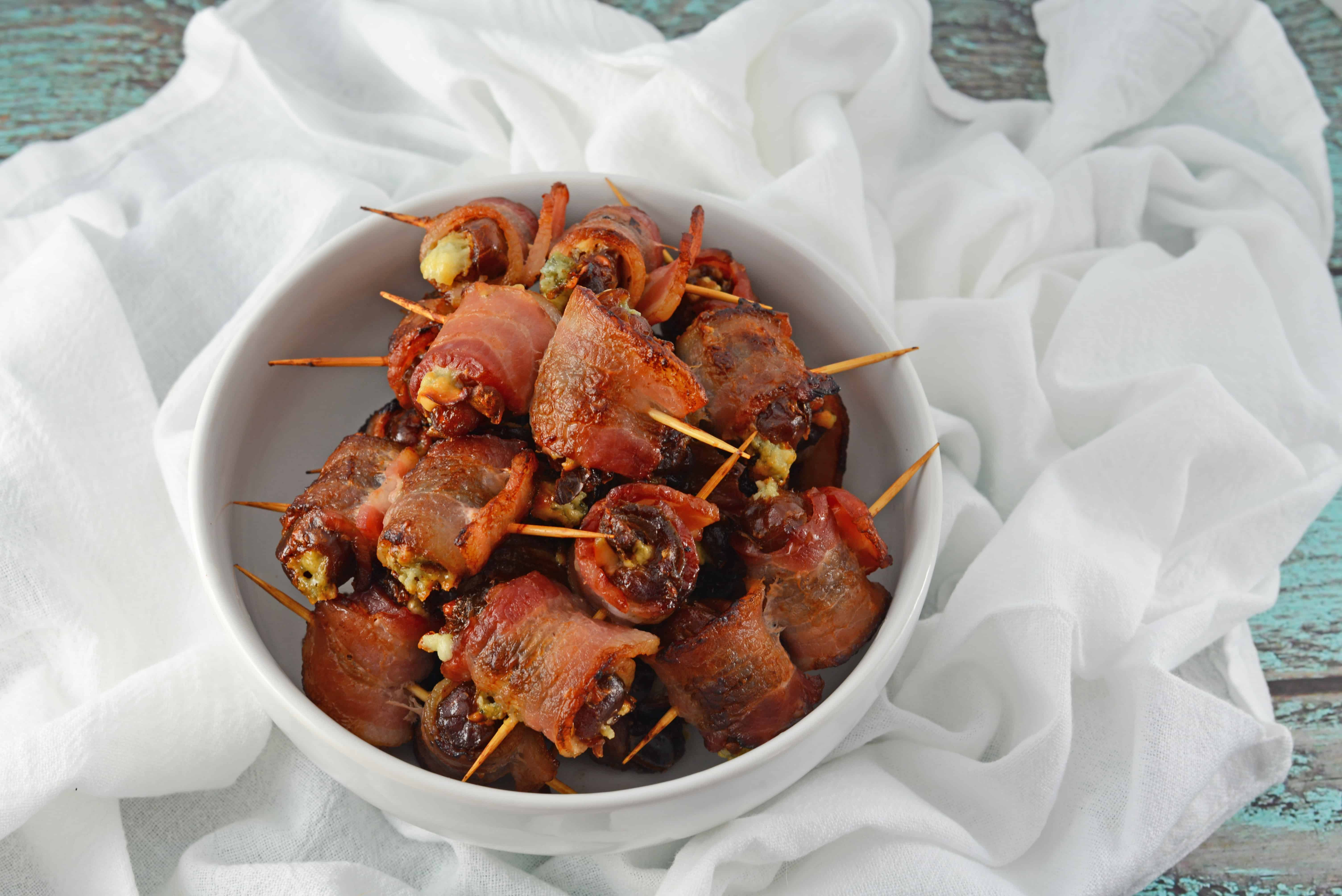 Bacon Wrapped Dates are an easy, 4 ingredient appetizer or snack perfect for watching the big game in your pajamas or a fancy cocktail party.