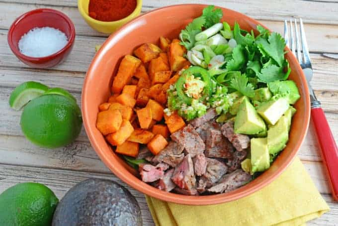 """A Beef Bowl using seasoned flank steak, spinach, baked sweet potatoes, cilantro, jalapeno, garlic and avocado, making it gluten-free and """"whole""""."""