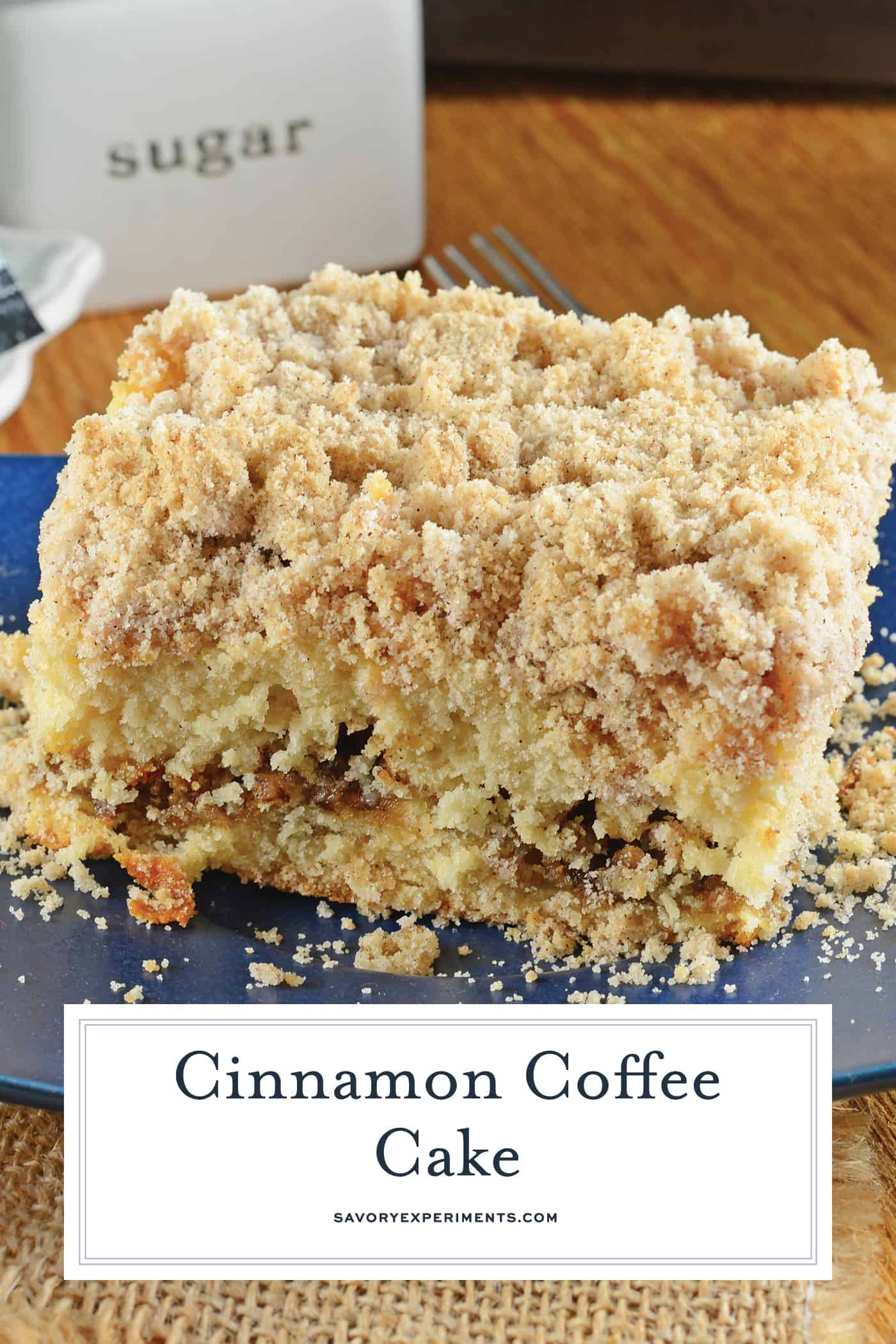 This is a classic Cinnamon Coffee Cake. Cinnamon streusel topping and a ribbon of brown sugar filling make this moist cake perfect for breakfast or brunch. #cinnamoncoffeecake #bestcoffeecake www.savoryexperiments.com