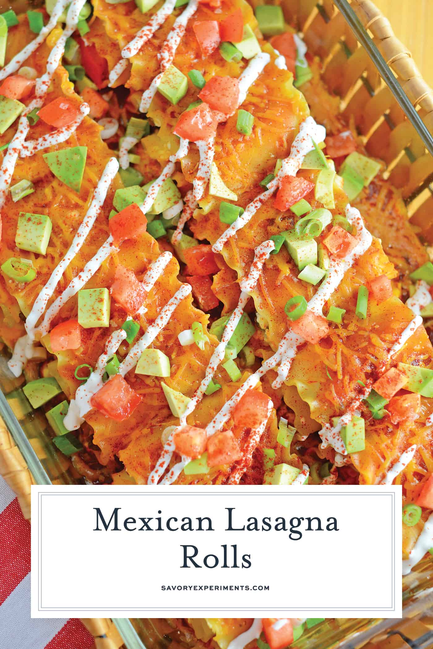 Mexican Lasagna Rolls are the best marriage of taco lasagna and traditional lasagna! They're so easy to put together, even the kids can help make them! #lasagnarollsrecipe #lasagnarollups #mexicanlasagnarecipes www.savoryexperiments.com