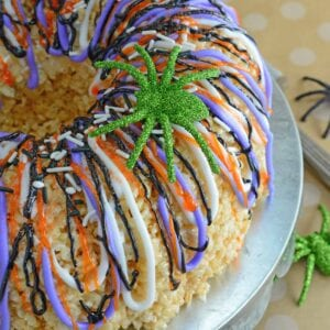 Halloween Rice Krispie Cake is stuffed with fluff! What better way to celebrate the holiday than with a giant homemade rice krispies treat?