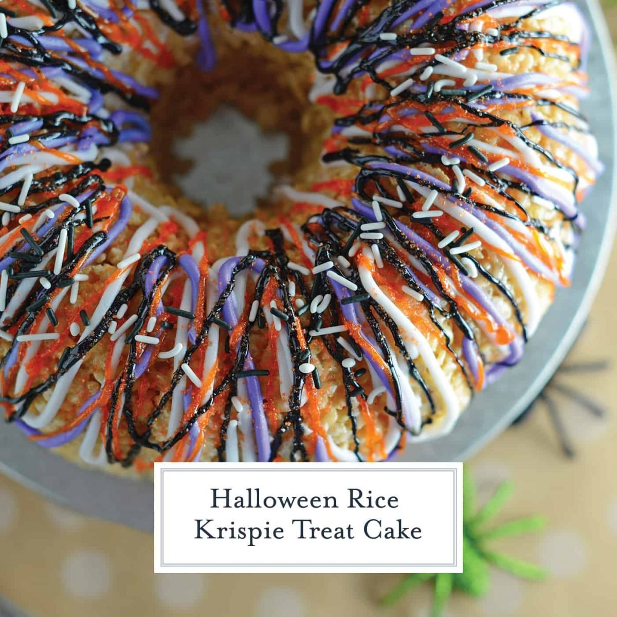 Halloween Rice Krispie Treat Cake is stuffed with fluff! What better way to celebrate the holiday than with a giant homemade rice krispies treat? #halloweenricekrispietreats #ricekrispietreatcake #halloweensnacks www.savoryexperiments.com