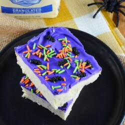 Halloween Sugar Cookie Bars are thick and chewy, frosted with a classic buttercream and topped with festive sprinkles.