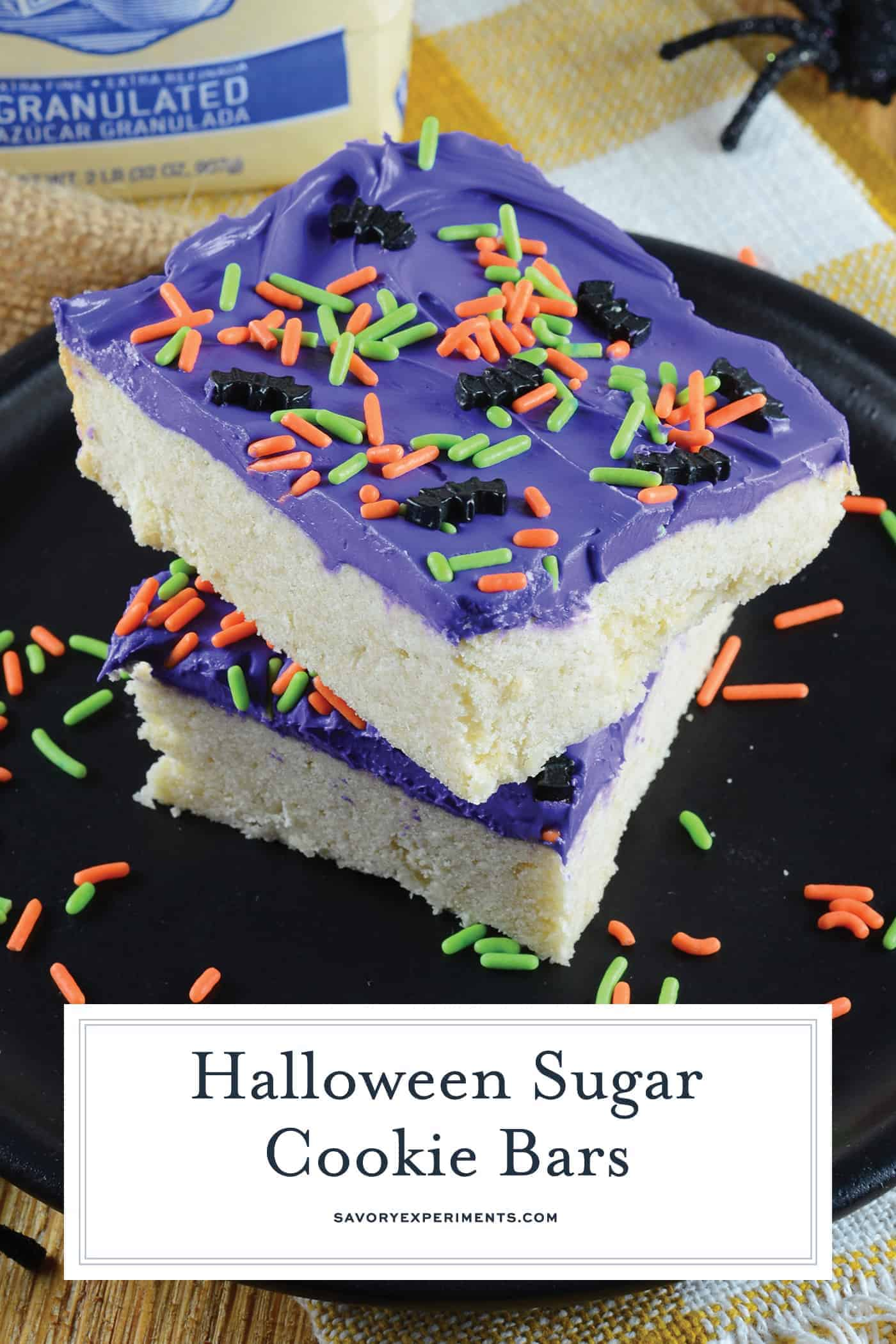 Halloween Sugar Cookie Bars are thick and chewy, frosted with a classic buttercream and topped with festive sprinkles. Perfect for the whole family! #sugarcookiebars #halloweendesserts #halloweensnacks www.savoryexperiments.com