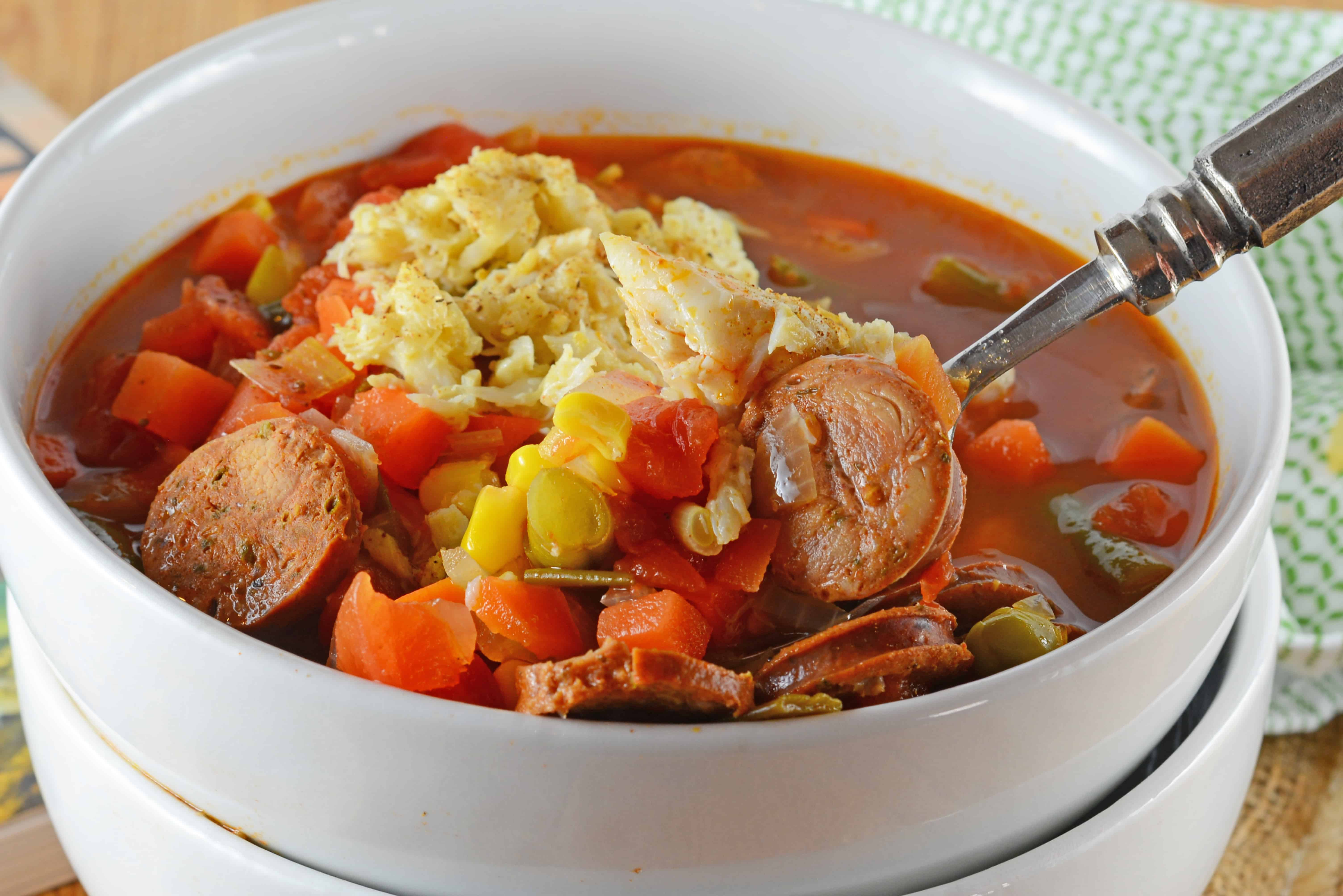 Spicy Crab and Sausage Soup is a quick, easy and flavorful appetizer or dinner recipes. Full of vegetables, sausage and crab, you can't go wrong!