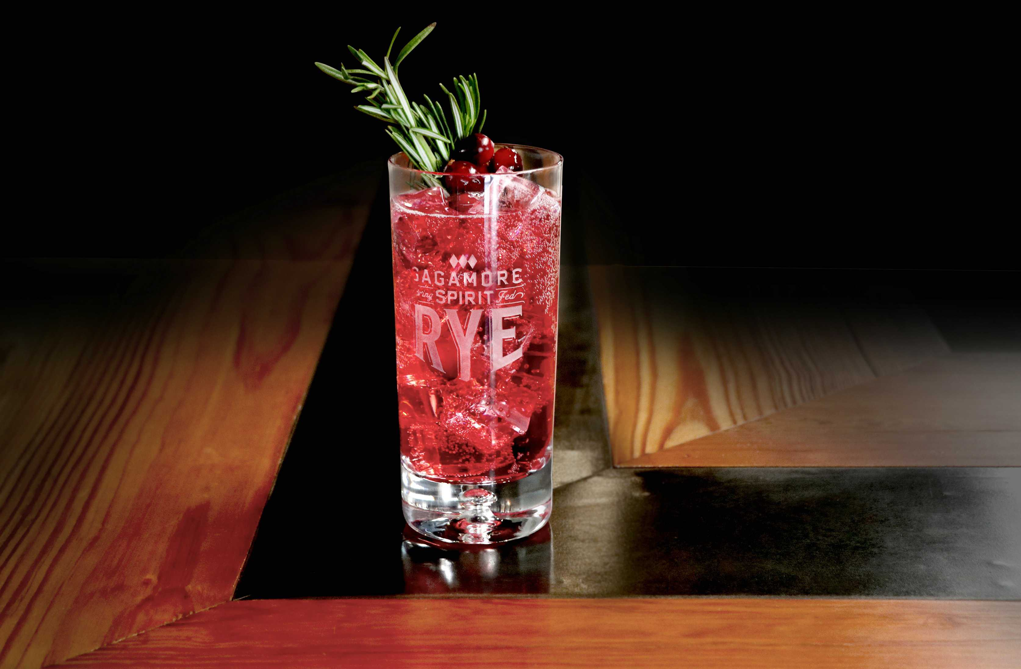 Holiday Whiskey Fizz is a bubbly holiday cocktail featuring Sagamore Spirits rye whiskey, club soda, cranberry syrup and lime juice.
