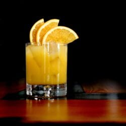 Orange Frost Cocktail is a refreshing and festive holiday cocktail. Blended with Sagamore Spirit rye whiskey, lemon and orange juice and maple syrup, make this your holiday party cocktail!