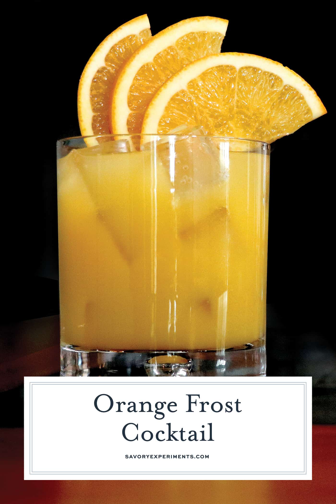 Orange Frost Cocktail is a refreshing and festive holiday cocktail using whiskey, lemon and orange juice and maple syrup. Make this your holiday party cocktail! #whiskeycocktails www.savoryexperiments.com