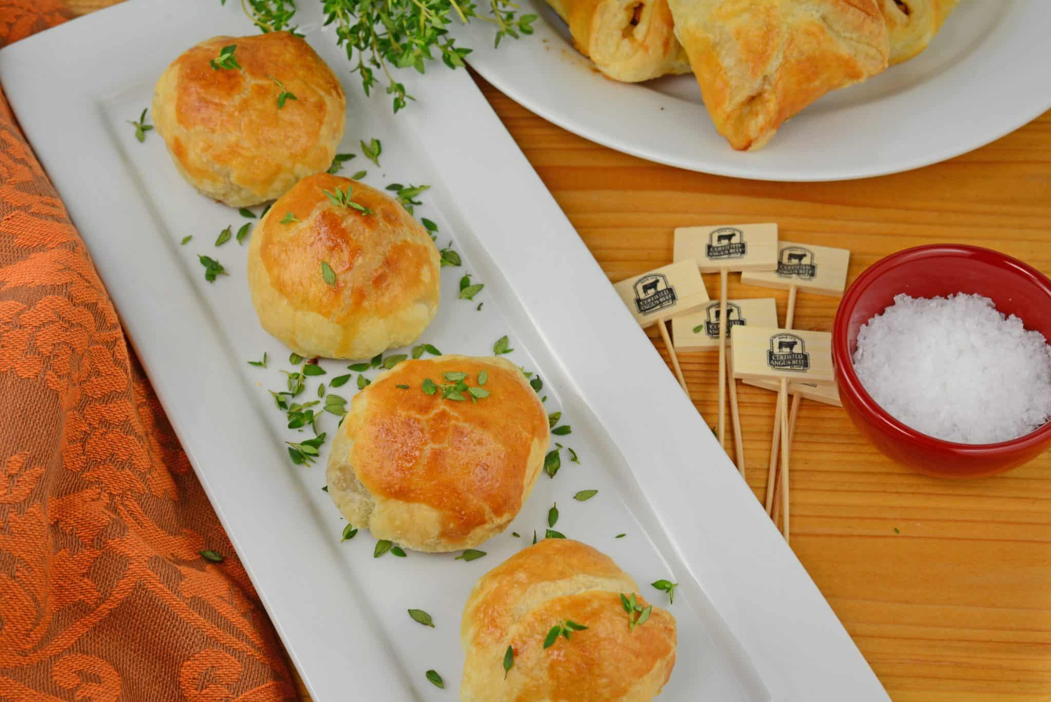 Mini Beef Wellington is one of the best party appetizers out there! Mini pieces of beef tenderloin seasoned with mushrooms, thyme, Dijon and prosciutto, all tucked into puff pastry.