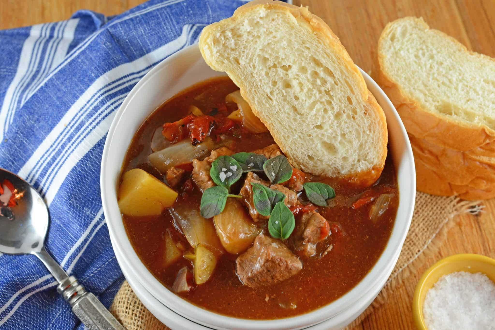 Beef Stew is one of the most iconic comfort foods and this version features tender beef, onions, potatoes, fire roasted tomatoes in a rich herb filled stew. This recipe can be made in the slow cooker or Dutch oven.