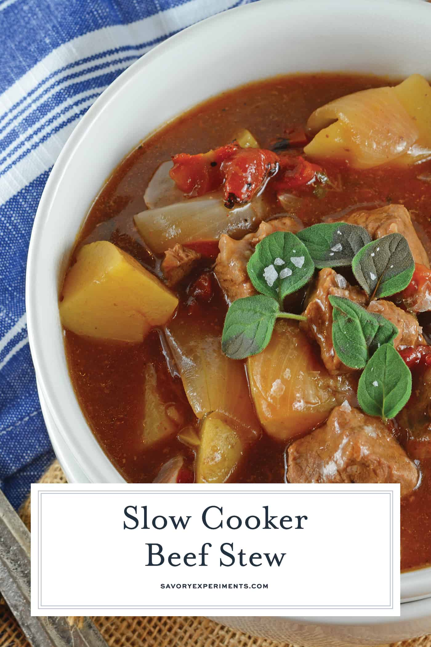 Slow Cooker Beef Stew is one of the best comfort foods to enjoy! It features tender beef, onions, potatoes, and fire roasted tomatoes in a rich herb stew! #crockpotbeefstew #slowcookerbeefstew www.savoryexperiments.com