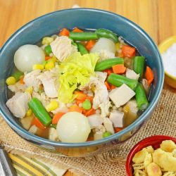 Bowl of turkey noodle soup with dill seasoned oyster crackers