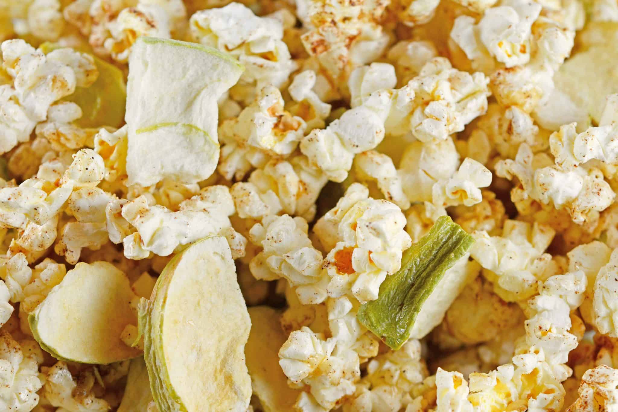Apple Cinnamon Popcorn is a great way to enjoy popcorn as a dessert or snack. Tossed with apple chips, honey, cinnamon and vanilla, you will crave this popcorn seasoning every day!