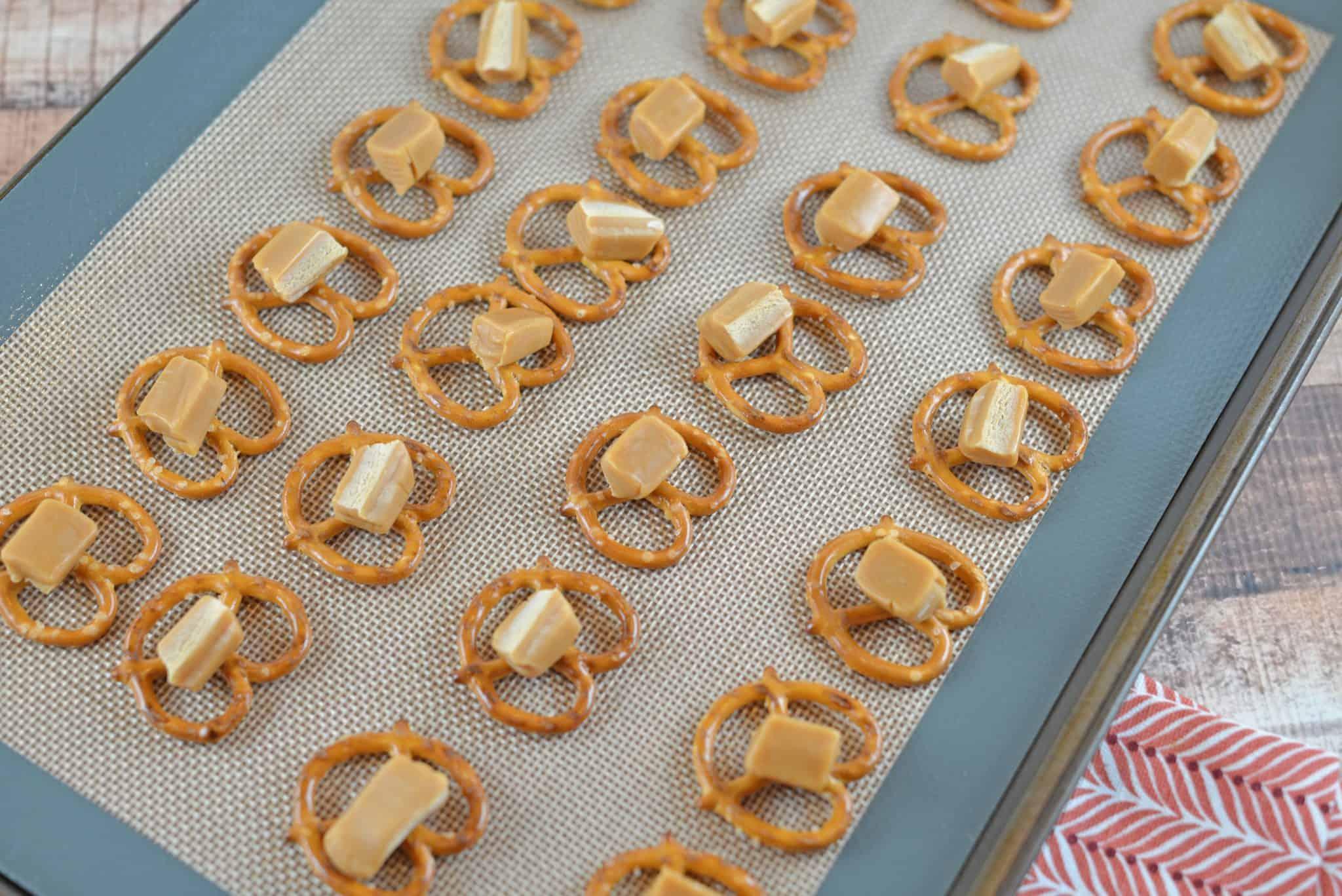 A close up of pretzels with caramel pieces
