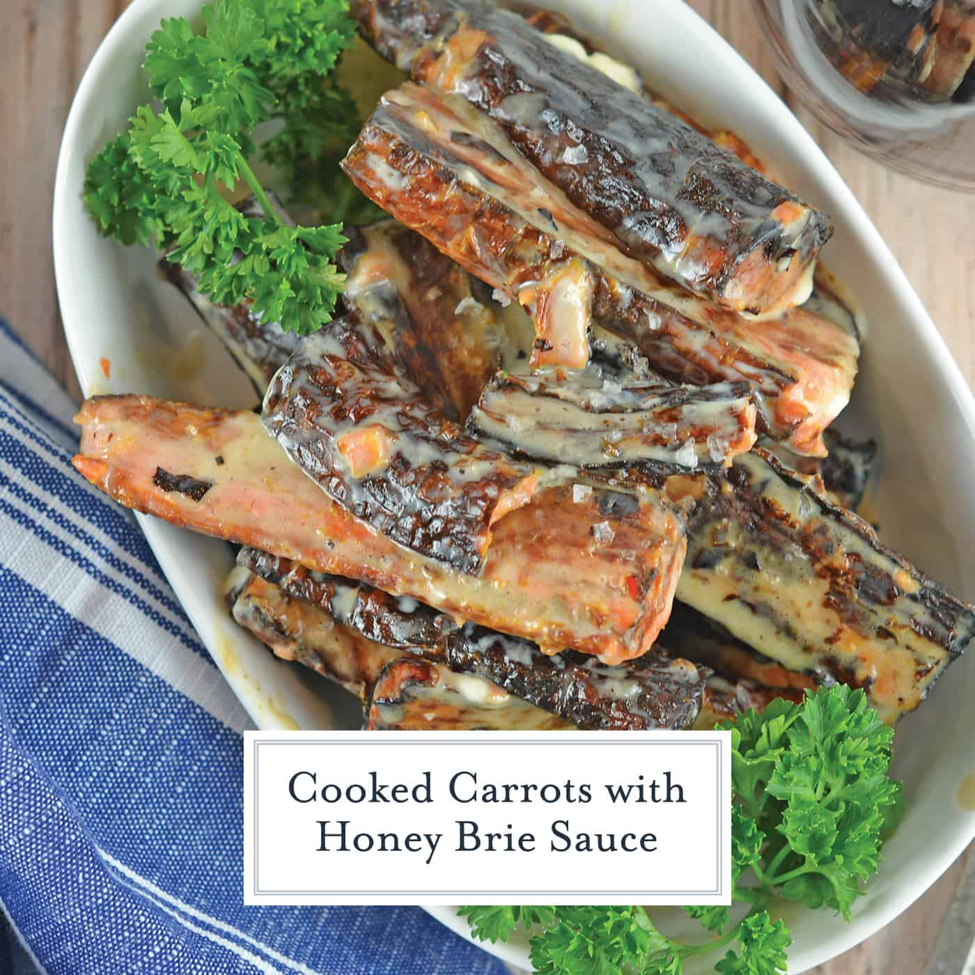 Cooked Carrots with Honey Brie Sauce are charred to a soft texture then tossed in cheese and honey. You'll never look at burned food the same way again! #cookedcarrots #carrotsidedish #carrotrecipes www.savoryexperiments.com