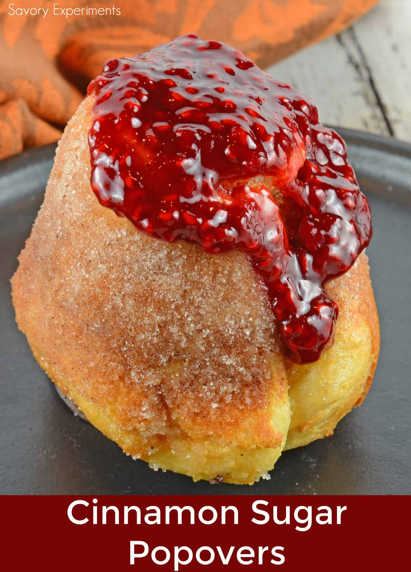 Cinnamon Sugar Popovers are easier to make then you think! A crispy outside and chewy inside coated with cinnamon and sugar, then drizzled in a fresh raspberry sauce.