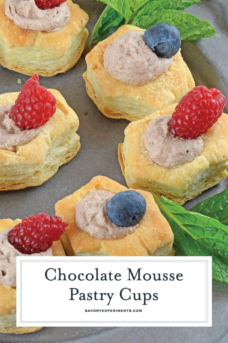 Close up of chocolate mousse pastry cups with fresh fruit