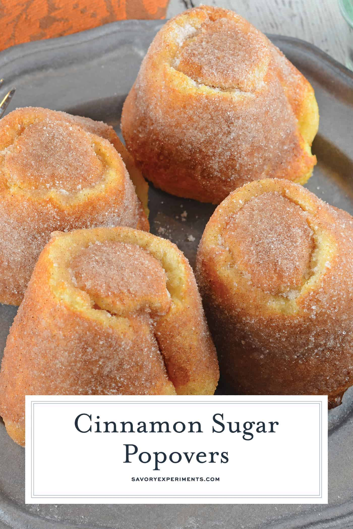 Cinnamon Sugar Popovers are easier to make than you think! A crispy outside and chewy inside coated with cinnamon and sugar, then drizzled in a fresh raspberry sauce. Perfect for a decadent breakfast or dessert. #popovers #howtomakepopovers www.savoryexperiments.com
