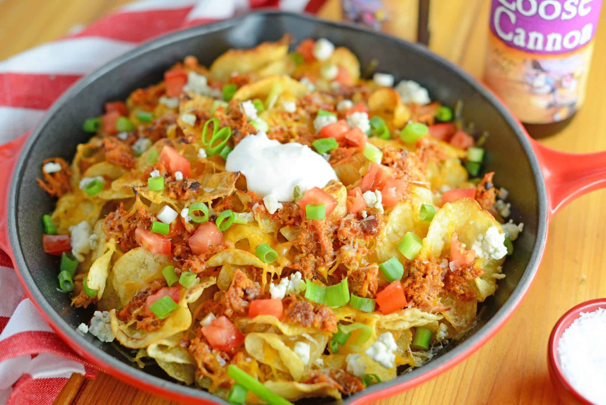 Pulled Pork Potato Chip Nachos are an easy appetizer or meal that your whole family will love made with kettle cooked potato chips and zesty pulled pork!
