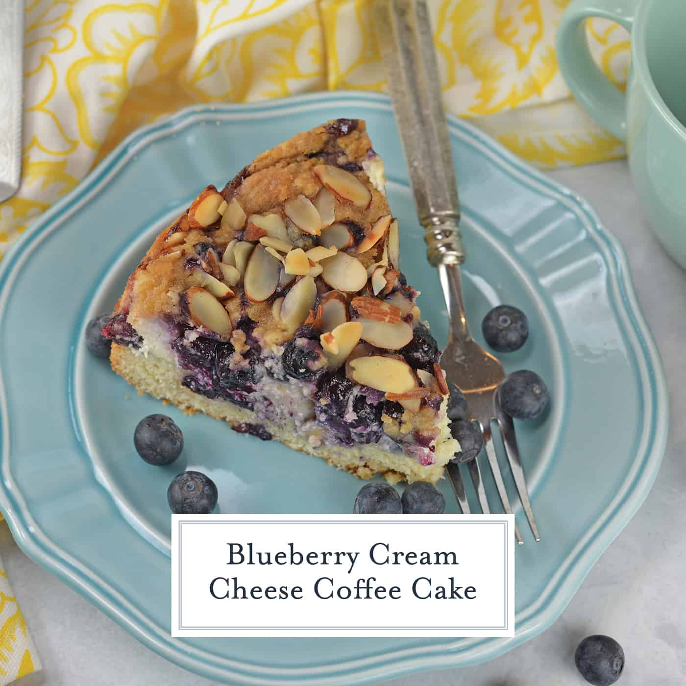 Blueberry Cream Cheese Coffee Cake is an easy coffee cake recipe with three layers of tender cake, silky cream cheese and almond streusel topping. #creamcheesecoffeecake #coffeecakerecipe #creamcheesecoffeecake www.savoryexperiments.com