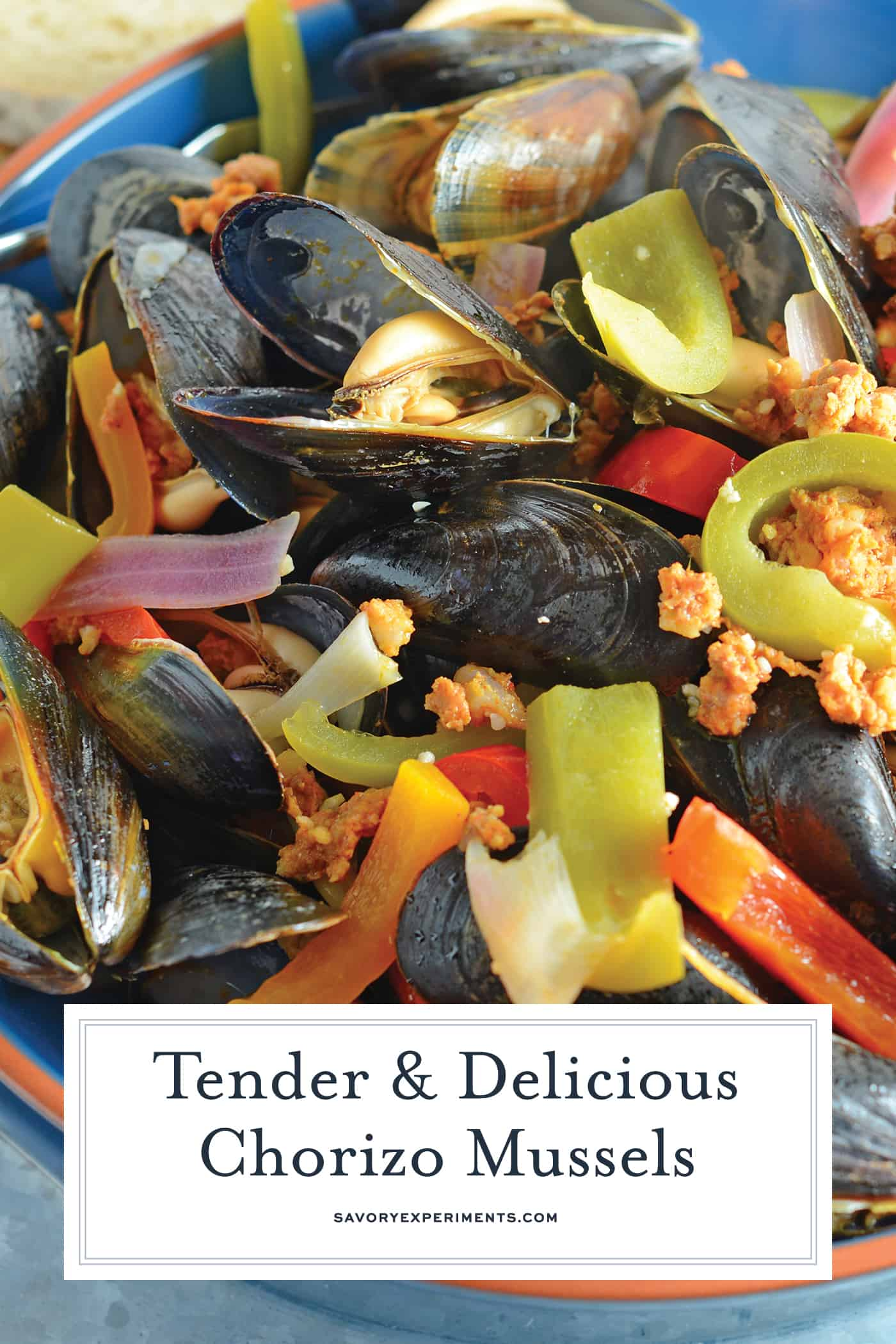 Chorizo Mussels are succulent, luscious tender mussels in a savory butter, chorizo wine sauce. Crusty bread is a must!#steamedmussels #easymusselrecipes #steampot www.savoryexperiments.com