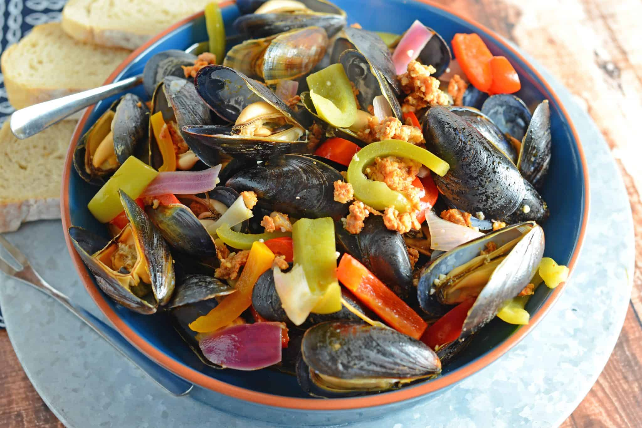 Chorizo Mussels are succulent, luscious, tender Mussels in a savory butter, chorizo wine sauce. It's SO good, it's slurp-worthy. Crusty bread for sopping up broth is a must!
