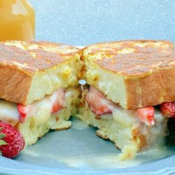 Strawberry Stuffed French Toast is made with mascarpone, Dutch honey syrup, fresh strawberries, and buttery brioche, pound cake, or angel food, for a perfectly delicious dish to enjoy for breakfast! #stuffedfrenchtoast #creamcheesestuffedfrenchtoast www.savoryexperiments.com