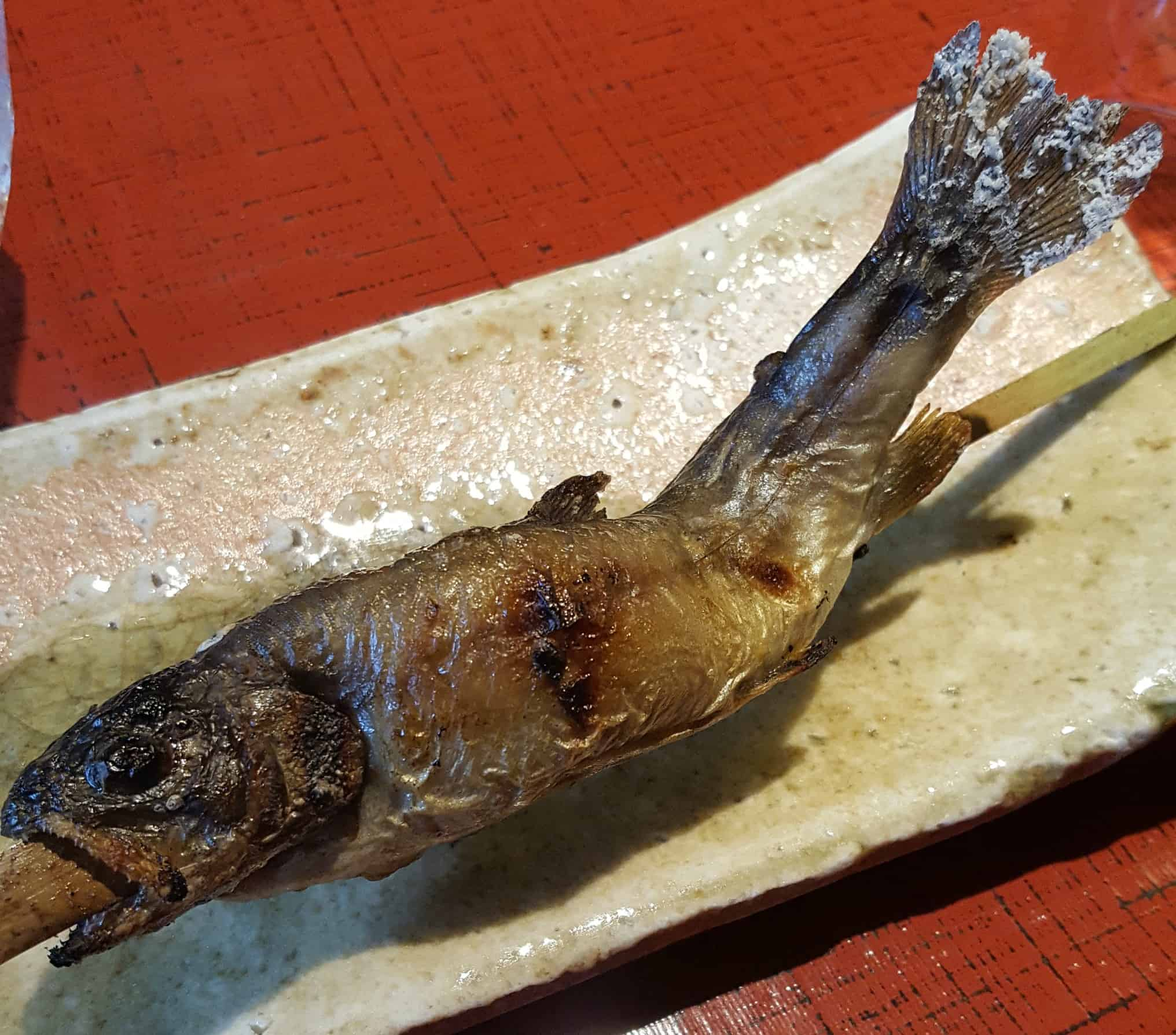 fried fish on a skewer