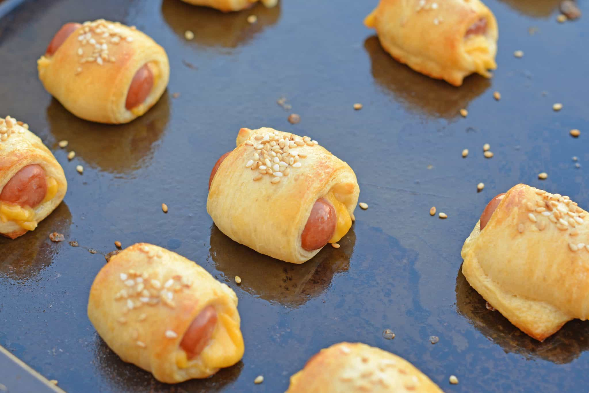 Pigs in a Blanket are great, but what if you made them into CHEESY pigs in a blanket? Serve with homemade creamy honey mustard sauce!