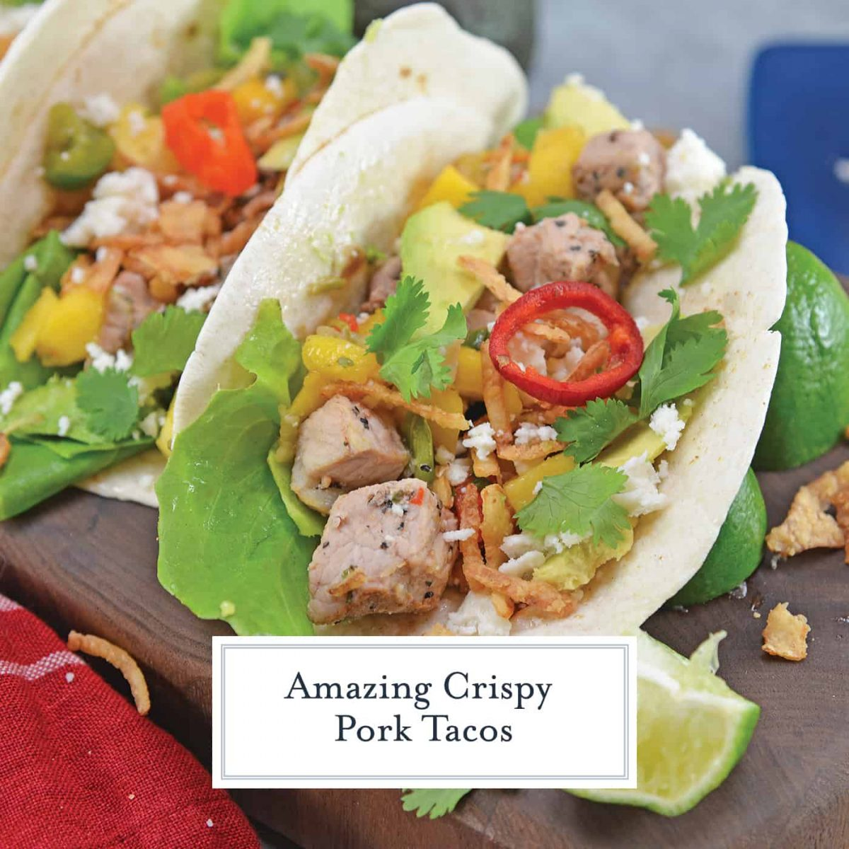 Crispy Pork Tacos are soft tacos filled with mango salsa, cool avocado, crumbly queso fresco, butter lettuce and crispy onion straws. #porktacos #streettacos #homemadetacos www.savoryexperiments.com