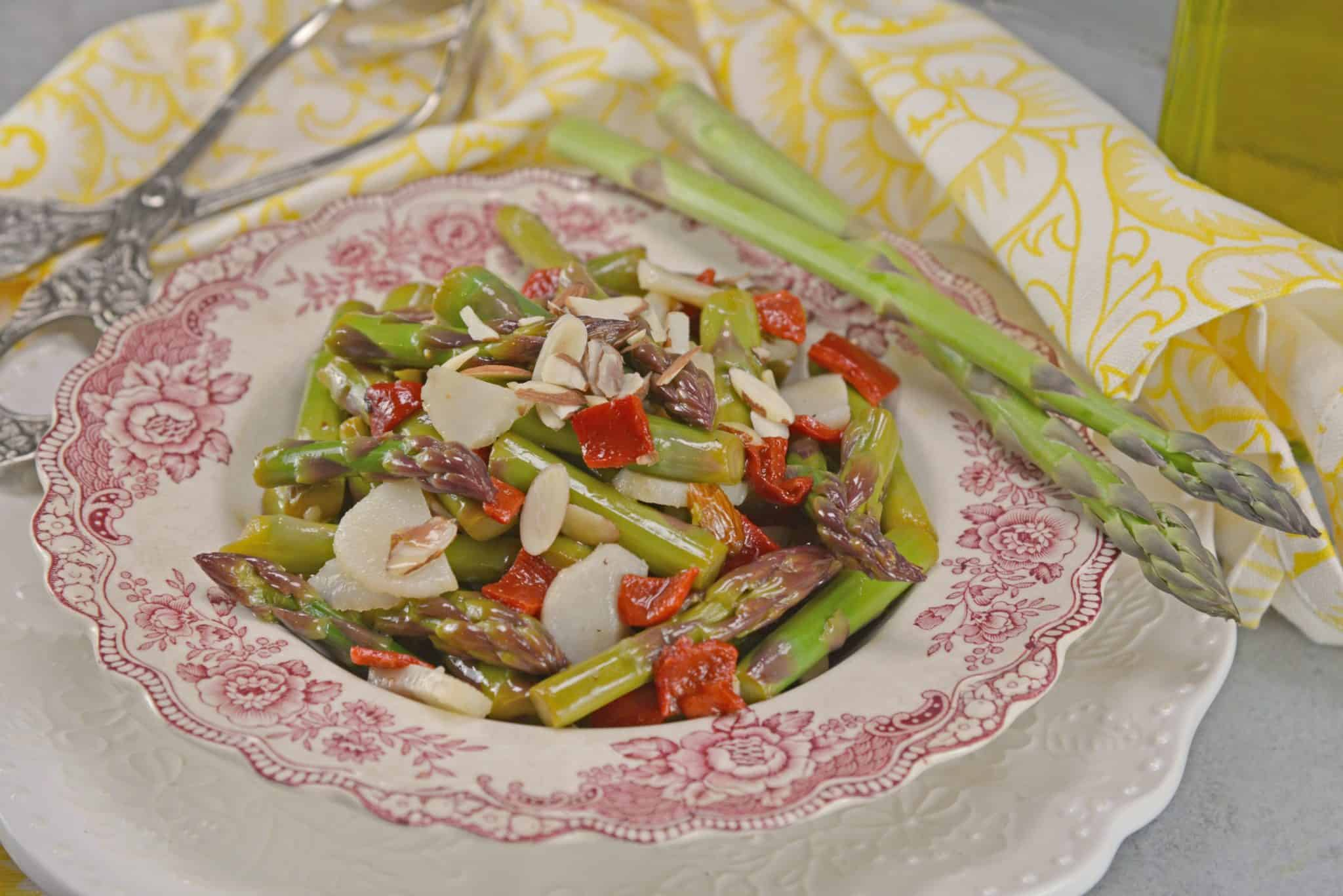 Pickled Asparagus Salad is made with blanched asparagus marinated in a vinaigrette and tossed with water chestnuts, roasted red pepper and almonds.