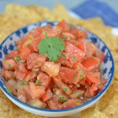 Pico de Gallo, also known as salsa fresca, is made from fresh tomato, onion, cilantro, hot pepper and lime juice. Perfect with tortilla chips! #picodegallo #homemadesalsa www.savoryexperiments.com